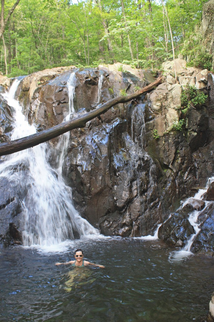 Taking a dip in a mountain waterfall pool